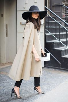 The Best New York Fashion Week Street Style // The hat, the Cape trench, the lace heels... YSLCape, Lela RosePants, ZaraShoes, Manolo Blahnik