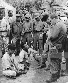 Suspected Communists captured near the lines are brought in for questioning, and later released during the Korean War. Get premium, high resolution news photos at Getty Images World History, World War Ii, World Conflicts, Korean People, Prisoners Of War, Korean War, American Soldiers, Cold War, Troops