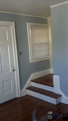 Living room paint job in grey blue...note before color behind the stairs