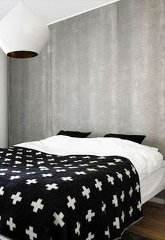 black, white and concrete | White Stout Beat light by Tom Dixon | bedroom