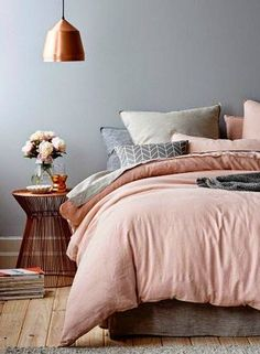 Copper details are right at home in this grey and blush bedroom