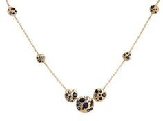 These seven Crystal discs of varying sizes sit on a fine 18 carat gold chain to create a beautifully balanced necklace that frames the collarbone. Each disc of gold encases sapphires of blue, the darkest midnight blue and velvety black. Pictured in 18ct Yellow Gold 1.5ct Sapphires Dimensions:4x 5.7mm small discs/2×8.5mm medium discs/1x11mm large disc  Also available: in single-colour sapphires  ... Read more