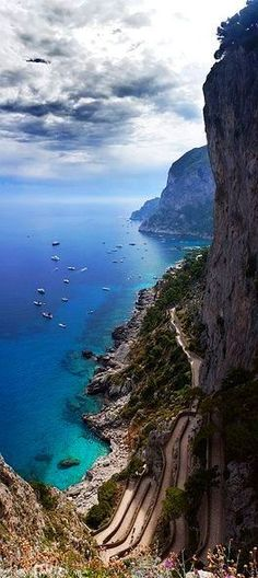 Capri Italy - Celebrated for its natural beauty, rich history, mild climate & breathtaking vistas, the Island of Capri is one of the most well-known tourist destinations in Italy. Old-world charm, gorgeous grottoes and silver- and rose-colored cliffs that plunge straight into clear blue water. Also expect superb restaurants, good shopping, watersports, lush gardens, Roman ruins, churches and wonderful streets in which to stroll.