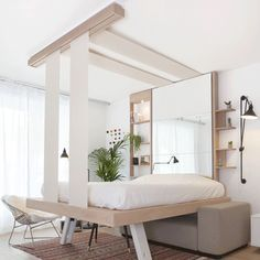Instead of folding against a wall, the space-saving BedUp by Décadrages can be hoisted up to the ceiling to create more room in studio apartments