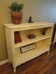 Shabby Chic Bookcase - painted a pale yellow and then distressed in all the  right places