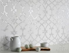 Avila, a natural stone waterjet and hand cut mosaic shown in Thassos honed and Statuarietto polished, is part of the Miraflores Collection by Paul Schatz for New Ravenna Mosaics.