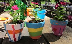 Fun garden activity for a birthday party. Kids paint their own pots and then plant flowers in them & take home. Doing this!