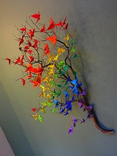 Origami cranes on a branch. I would love to do it with butterflies.....