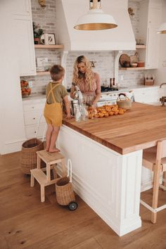 Today we are sharing the kitchen of Amber Fillerup Clark of Barefoot Blonde. This warm space uses a brick backsplash, Carrera marble and butcher block counters, White Dove paint and a Lacanache Range for a beautiful Old World vibe. New Kitchen, Kitchen Decor, Kitchen Design, Butcher Block Island, Farmhouse Kitchen Island, Farmhouse Kitchens, White Wash Brick, Kitchen Backsplash, Backsplash Ideas