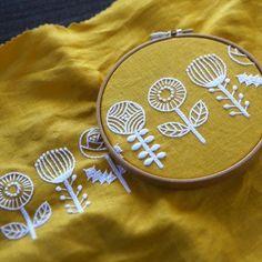 White flowers on mustard fabric hoop art