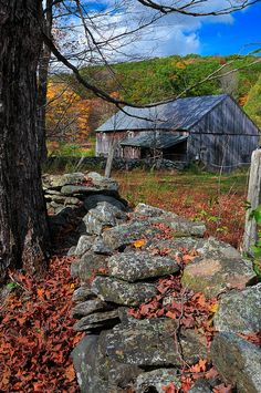 Rustic barn ~  old stones like these were put under the post foundations of old houses and a coin was laid upon the stone..this was thought to bring good luck.