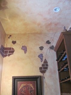 Faux paint with fake bricks and grapes in a wine room.  Beautiful