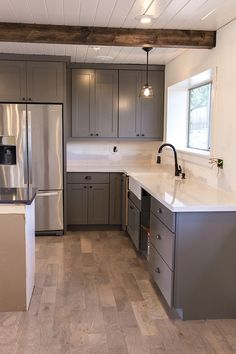 Jenna Sue: Kitchen Chronicles: The counters are in! (+ pendant light and faucet… Dark Grey Kitchen Cabinets, Grey Kitchens, Home Kitchens, Lowes Kitchen Cabinets, Kitchen Redo, New Kitchen, Kitchen Remodel, Kitchen Dining, Kitchenette