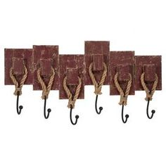 "Bring a classic touch to your entryway or mudroom with these distressed wall hooks, showcasing jute accents for rustic appeal.   Product: Wall rack Construction Material: Engineered wood, metal and jute Color: Distressed brown  Features:Six hooks   Dimensions: 13.5"" H x 24.5"" W x 2.75"" D"