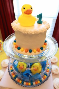 A rubber ducky cake I made along with the design of how it was displayed.
