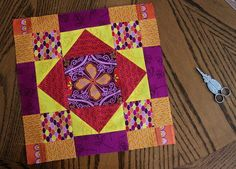 Embrace the brighter shades of fall with this pretty quilt block in colors like pumpkin orange, magenta, and bright yellow. The New Leaf Quilt Block is a gorgeous fall quilt block that lets you show off your fussy cutting skills and uses easy half-sq Quilting Tutorials, Quilting Projects, Quilting Designs, Beginner Quilting, Quilt Design, Quilting Ideas, Sewing Projects, Quilt Block Patterns, Pattern Blocks