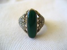 Vintage / Sterling Silver / Oval Jade Stone / Womens / Teens Marcasite Ring / Accessories at MeloArtGallery on Etsy. $39.00, via Etsy.