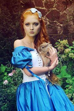 http://fc04.deviantart.net/fs71/i/2011/139/0/8/alice_with_the_rabbit_by_voodica-d3gpvjk.jpg