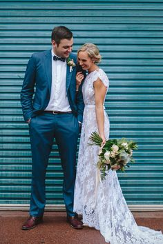 Rue De Seine lace wedding dress and blue groom suit | Merge Photography