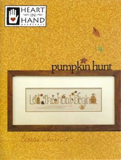 """Stitched on 32 ct Summer Khaki Belfast Linen using Sampler Thread, Anchor or DMC. This cross stitch pattern, Pumpkin Hunt by Heart in Hand, features the phrase """"Let the hunt begin"""" with pumpkins, flowers, cats, and more. The pattern is 201x54!"""