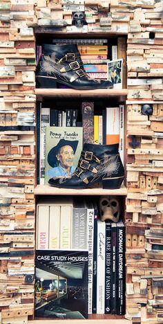 Bookshelves & boots. www.thecoveteur.com/kemal_harris
