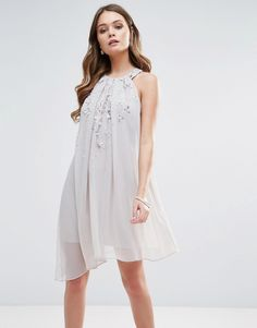 Buy it now. Lipsy Floral Embellished Swing Dress - Grey. Dress by Lipsy, Woven fabric, Crew neck, Chiffon overlay, Bead and sequin embellishment, Keyhole back, Loose fit � falls loosely over the body, Hand wash, 100% Polyester, Our model wears a UK 8/EU 36/US 4 and is 170cm/5'7 tall. ABOUT LIPSY Renowned for their statement party dresses, London fashion brand Lipsy channel a young, fun vibe in their partywear, footwear and jewellery collections. Dedicated to delivering fashion forward…