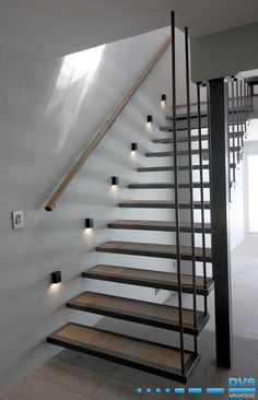 Steel cantilevered stairs with timber inlays