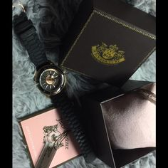Black and rose gold Juicy Couture watch Brand new with tags juicy couture watch. Never been used, this watch is super cute and unique. Nice piece to add to your closet. Comes with everything you see. Needs new battery Juicy Couture Accessories Watches