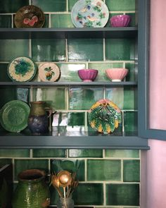 Green tiles, pink walls and the prettiest old plates and bowls in our new St. john's Square showroom.
