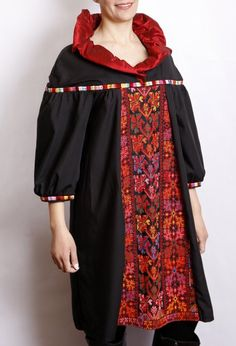 Free size kneelength black cotton dress with three quarter sleeves, the dress includes a front piece of old Palestinian embroidery and a red silk collar.