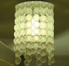 Bottle Cap Lamp Shade. Turn those old water bottles into something good.