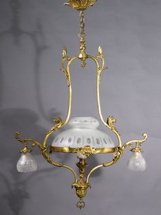 """Circa 1895, this 3-light Gas & Electric Chandelier is gilt bronze with cut glass shades and stellar detail. 45"""" drop x 30""""width and a center shade of 14"""" diameter x 8"""" depth. $4110.00"""