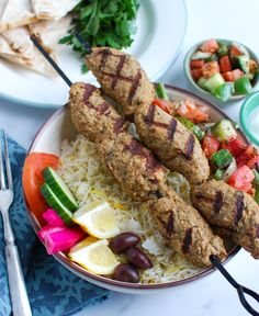 Chicken Kofta is the perfect Mediterranean meal that you can eat on its own, in a pita sandwich, hummus or rice bowls. Ground chicken is mixed with fresh herbs, warm spices, garlic, onion and breadcrumbs to create a delicious kebab. You can easily grill, bake or cook these on a skillet.// acedarspoon.com #kafta #kofta #chicken #Mediterraneandiet #dinner