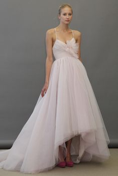 """Brides: Jim Hjelm Blush - Fall 2012. Style 1258, """"Lilac"""" pink and purple layered tulle ball gown wedding dress with a high-low hem, spaghetti straps, and floral detail at the bust, Blush by Hayley Paige"""