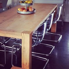ikea tobias chairs + crate and barrel big sur table. love the mix of rustic + modern.
