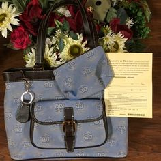 """AUTHENTIC VERY RARE DOONEY AND BOURKE-3pcs- New DOONEY and BOURKE SIGNATURE DONENGAL CREST EAST WEST SHOULDER BAG WITH MATCHING MAKEUP POUCH.GORGEOUS DENIM BLUE W/ BLACK VACCHETTA LEATHER TRIM.THIS SET WAS ORIGINALLY MADE FOR QVC & FAR MORE EXPENSIVE   BEAUTIFUL & RARE DONENGAL CREST SIGNATURE PATTERN NWOT & HAS REGISTRATION CARD TO VERIFY AUTHENTICITY FULLY LINED 10""""H x 13.5""""Lx 4.5""""D ZIPPER POCKET CELL POCKET & KEY CLIP GOLD TONE ZIPPER DUAL SHOULDER STRAPS SCOTCH GUARDED COTTON GOLD TONE…"""