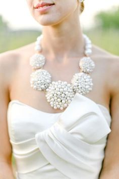 Not into leaving your neck naked? A big, bold statement necklace will set off your wedding day look. Dramatic, unique and eye-catching, these necklaces are the outgoing best friend of a strapless wedding dress.