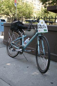 "Beautiful light blue bike with ""I Bike Polite"" ambassador badge on the front."