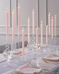 Love these assortment of clear candle holders.  Could be a great center piece idea.