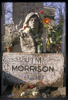 Jim Morrison is buried in Père Lachaise Cemetery in Paris, one of the city's most visited tourist attractions. Jim Morrison Grave, The Doors Jim Morrison, Jimi Hendricks, Pere Lachaise Cemetery, Old Cemeteries, Graveyards, Famous Graves, Julius Caesar, Cemetery Art