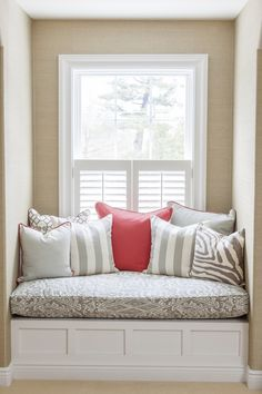 Neutral colored window seat pillows with a pop of color in the middle | Courtney Apple