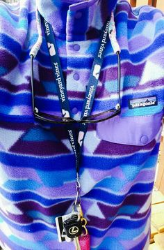 Vineyard Vines lanyard, Lilly Pulitzer croakie, and crazy Patagonia pullover
