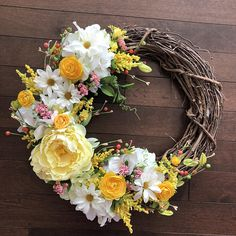 Sunshine is headed your way with this wreath. This has a wildflower feel and will be beautiful in both spring and summer seasons. If you love yellow- this is the wreath for you and is sure to be unique and beautiful on your front door. The purchase of this listing is for a spring wreath