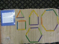 This is our polygon work. It consists of popsicle sticks and a chart of some simply polygons: triangle, quadrilateral, pentagon, hexagon, and octagon. I found this material on Counting Coconuts. This has been my latest inspiration for making materials for our classroom.  http://montessori-work.blogspot.com