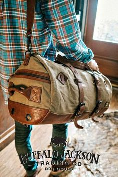 Crafted of waxed canvas and full grain leather with a distressed vintage finish, this military travel duffle bag was built to honor the memory of good men and good days. Most durable of canvases, and highest grade leather. Extra straps to convert to a backpack, and plenty of room for all your work, sport, or travel products. Great gift for him.