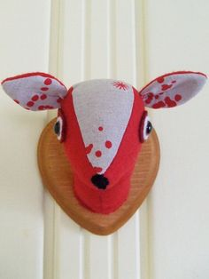 faux deer. I think its really cute for a babies room... but not sure if I want a faux taxidermy animal in my babies room...