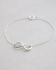 Infinity bracelet with Angel wing charm sterling silver dainty