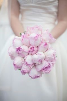Instead of peonies, I choose pink cabbage roses for my bouquet. For a March wedding, they're much more seasonal and cost efficient.