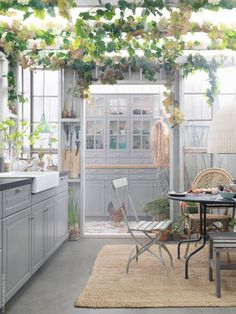 I love the vines overhead and the blurring of the lines between the garden and the kitchen. (Home and Delicious: IKEA and the new meted kitchens)