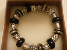 I'm selling Beautiful Sterling Silver Black Beads and Black and gold beads with Sterling Matching Charms! - $75.99